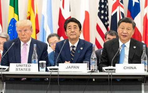 President Donald J. Trump, seated next to Japanese Prime Minister Shinzo Abe, listens as China's President Xi Jinping, right,