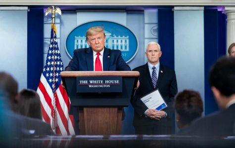 President Donald J. Trump, joined by Vice President Mike Pence and members of the White House Coronavirus Task Force, listens to a reporter's question at the coronavirus (COVID-19