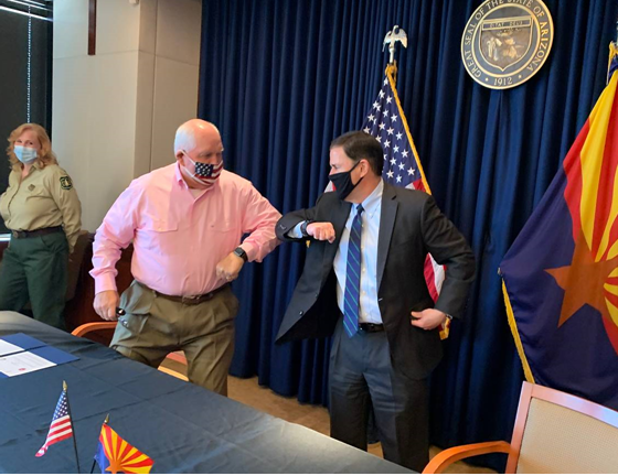 Agriculture Secretary Sonny Perdue and a masked Arizona Governor Doug Ducey