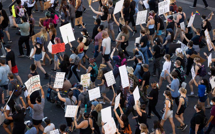 Protestors walk to Arizona City Hall