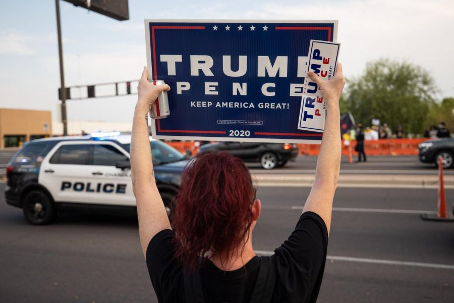 A demonstrator holds Trump-Pence sign during an earlier protest near Phoenix.