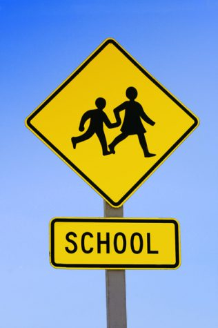 School Sign to cross road