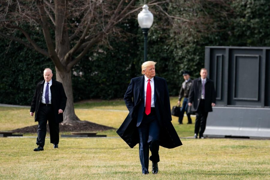 President Donald J. Trump walks across the South Lawn of the White House to board Marine One in January