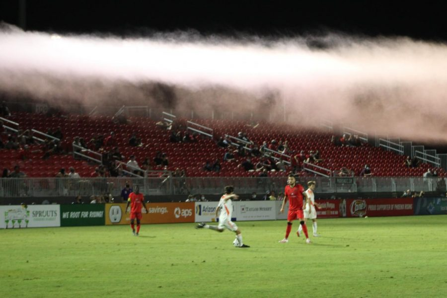 Orange County moves the ball into their offensive zone under a layer of red smoke from the south end zone following Rufat Dadashov