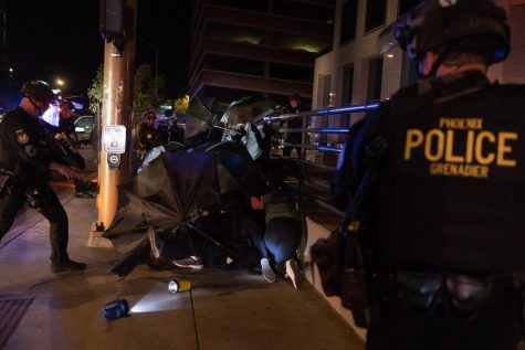 Protesters shielding from Phoenix Police on Van Buren St.