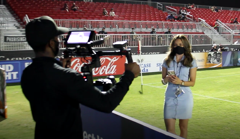 NEVN reporter Cynthia Tapia records a Phoenix Rising game preview with videographer Khiry Shabazz