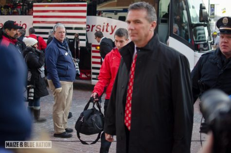 Urban Meyer draws some suspicious looks on the campus of arch rival Michigan in 2013