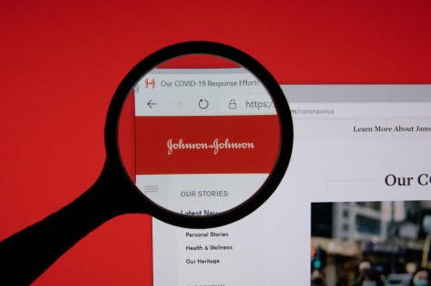 Johnson & Johnson company website page logo on laptop display with red background