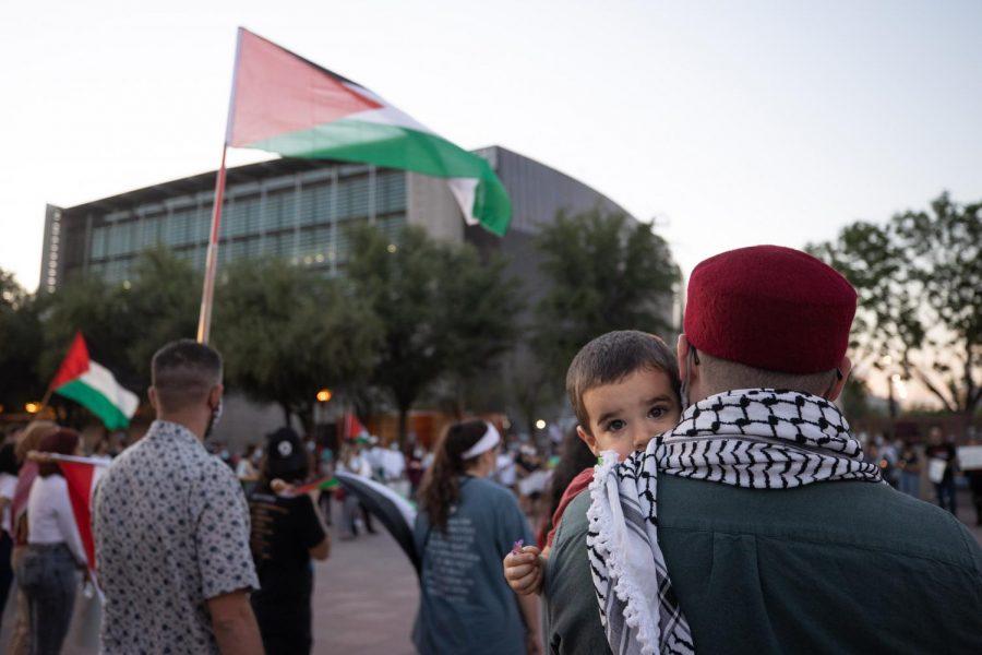 Palestine supporter listening to speakers