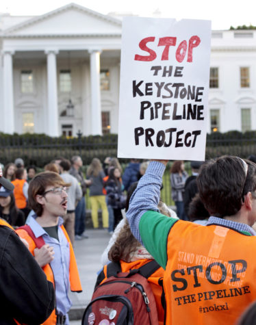 Protestors outside the White House demonstrate against the Keystone XL project in 2011. Pipeline construction began in 2008 and was spread across several phases — the last of which was shut down earlier this year.