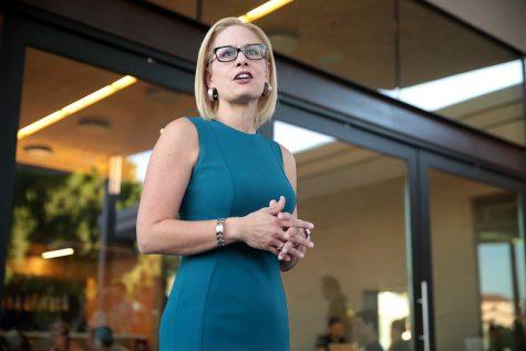 Kyrsten Sinema speaking with supporters in Phoenix.