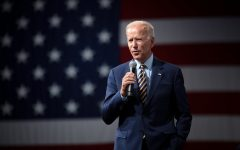 President Joe Biden — pictured here in Iowa — has come under sharp criticism as videos emerged of Border Patrol agents on horseback whipping asylum-seekers from Haiti.