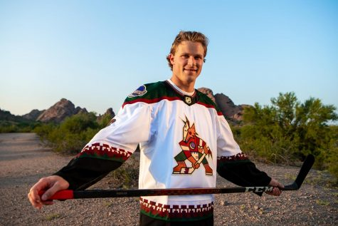 Coyotes defenseman Jakob Chychrun models the new jersey.